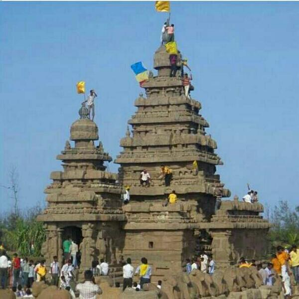 PMK Workers climbing on Shore temple